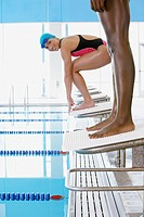 Swimmers on starting blocks
