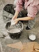 Sculptor mixing plaster