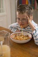 Boy playing with his spaghetti