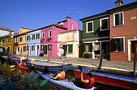 kayak trip on a canal of Burano island, Venice, Veneto region, Italy, Europe