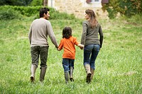 Family Walking in a Meadow