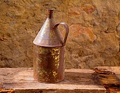 Antique rusted iron jar with aged brass on vintage wood self