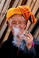 Cheroot, old woman smoking a typical cigar made of corn leaves in Inle, Myanmar, Burma