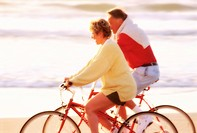 Couple Cycling Along Shore