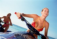 Two young women on jet skis
