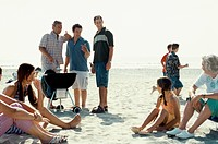 Family Barbecuing on the Beach