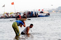 Devotees take a holy dip during the Ardh Kumbh Mela , one of the world's largest religious festivals as they are ferried at the confluence of the Gang...