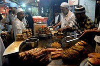 A food vendor prepare eatables as Muslims break their Ramzan or Ramadan fasting at Khatri Masjid in Pydhonie , Bombay now Mumbai , Maharashtra , India