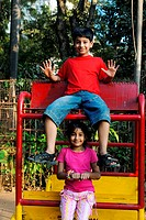 South Asian Indian brother and sister playing in garden , Bombay Mumbai , Maharashtra , India MR152