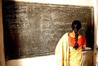 School teacher writing on blackboard ; Ngo Patang ; Sambalpur ; Orissa ; India MR717A