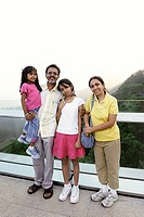 Family portrait on roof of Victoria peak with view of Hong Kong and Kowloon MR477
