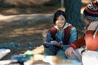 Young Woman Having Meal at Campsite