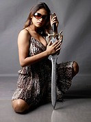 South Asian Indian model Krrishika Gupta holding sword MR718