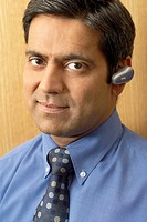 Businessman Using Bluetooth Wireless Headset
