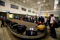 Passengers waiting for baggage and collecting from luggage belt at Chhatrapati Shivaji Maharaj International Airport ; Bombay Mumbai ; Maharashtra ; I...