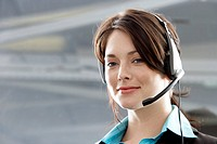 Businesswoman Using Headset