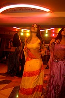 Decked up girls dancing in bar ; Bombay Mumbai ; Maharashtra ; India