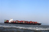 Fast moving huge cargo Ship fully loaded with container in Arabian sea near Gateway of India , Mumbai Bombay , Maharashtra , India