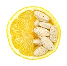 Close up of lemon and pills isolated _ vitamin concept