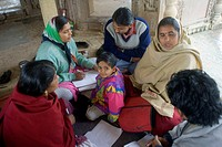 Social worker talking with villagers , Vanagana , Chitrakoot , Uttar Pradesh , India