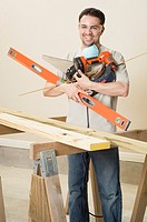 Man with arms full of tools