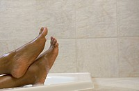 Feet in a bathtub