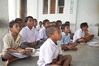 Children studding in Open Class ; Tamil Nadu ; India NO MR ; NO PR