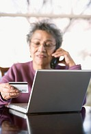 Older Woman Shopping Via Computer and Phone