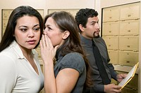 Co_workers Gossiping in Mailroom