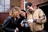 People watching photographs ; Salzwedel ; Germany ; Europe