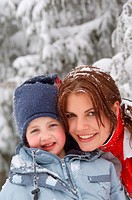 Young woman and boy in snowy landscape