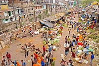 Mullick bazaar flower market scene from the Howrah Bridge ; Kolkata or Calcutta ; West Bengal ; India