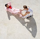 Young Couple Exercising on Patio