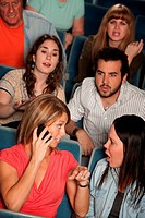 Women On Phone in Theater