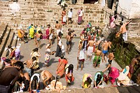 Devotees having holy water bath in the well ; Lonar ; Buldhana ; Vidharbha ; Maharashtra ; India
