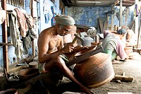 Making of copper utensils in vessel manufacturing industry in Anupparpalayam metal town , Tirupur , Tamil Nadu , India