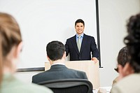 Businessman standing at podium