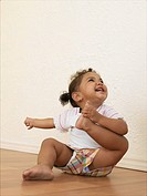 Toddler Holding Her Foot, Laughing