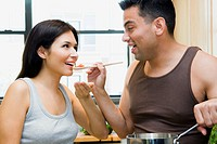Woman Tasting Husband´s Cooking