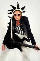 Funky female guitarist islated