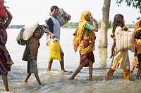 Kosi river flood in year 2008 which mostly made suffered below poverty line people in Purniya district , Bihar , India