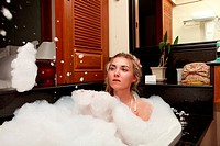 Pretty woman laying in bath