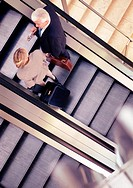 Businesspeople Ascending on an Escalator