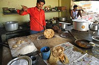 Man making roties at Dhaba at Pratapgar , Uttar Pradesh , India NO MR