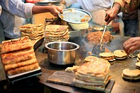 Chefs cooking Kheema Pav at a roadside restaurant on street during Ramzan , Mohammed Aii road , Bombay Mumbai , Maharashtra , India