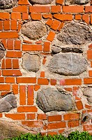 Big stones in red brick wall. Architecture closeup