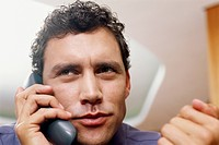 Close up of a man talking on the phone