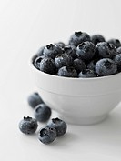 Washed Blueberries In and Beside a Bowl