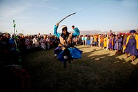 Nihang or Sikh warrior performing stunts with sword during the Hola Mohalla celebration at Anandpur sahib in Rupnagar district , Punjab , India