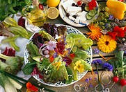 Mixed leaf salad with edible flowers, sheep´s cheese with olives and ingredients